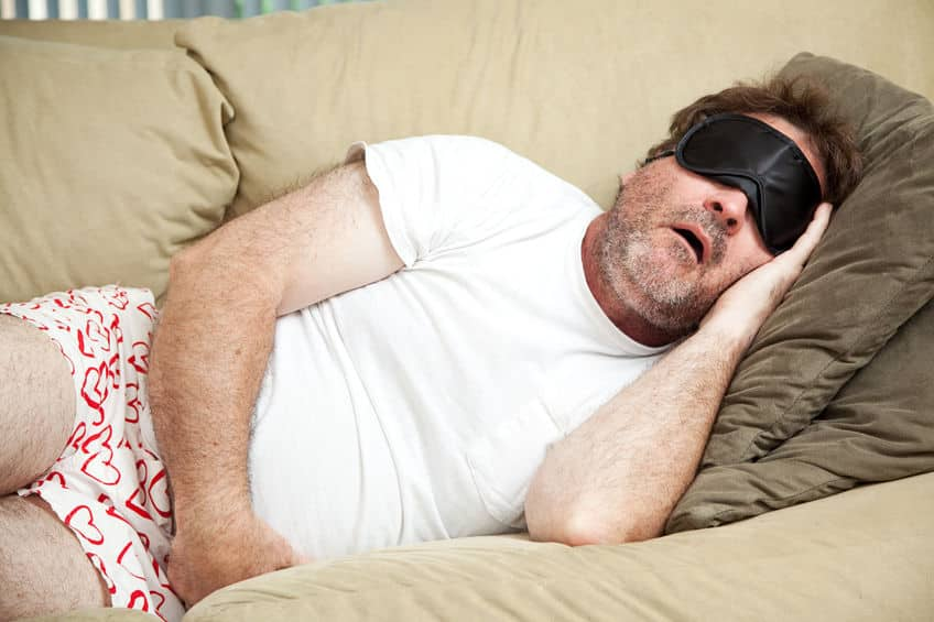 37126368 - lazy man at home in his underwear, sleeping on the couch and snoring.